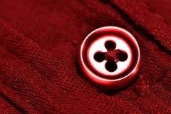 Czerwony guzik na Czerwonej koszula Obraz Royalty Free
