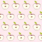 Czerwony jabłka cięcie w połówce z sednem i ziarnami Bezszwowy retro wzór na świetle - różowy tło Mieszkanie styl również zwrócić Obrazy Royalty Free