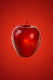Czerwony jabłko na czerwieni Zdjęcie Royalty Free