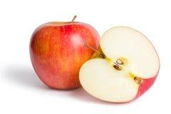 Czerwony jabłko z połówką obrazy royalty free