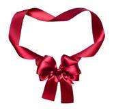 Czerwony jedwabniczy łęku i faborku dekoraci przedmiot na bielu jak ramę Zdjęcie Stock