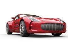 Czerwony kruszcowy szybki samochód na białym tle Fotografia Royalty Free