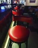 Czerwony krzesło w barze obraz stock