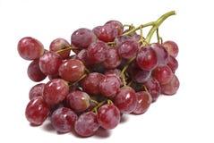 Czerwony kul ziemskich winogron bielu tło Zdjęcie Royalty Free