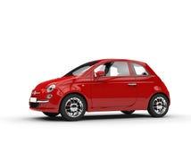 Czerwony Mały gospodarka samochód - Boczny widok Fotografia Stock