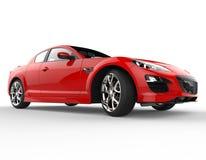 Czerwony Nowożytny samochód wyścigowy na Białym tle - Pracowniany oświetlenie Obrazy Stock