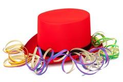 Czerwony odgórny kapelusz z streamers Fotografia Royalty Free