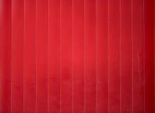 Czerwony olśniewający metalu ogrodzenie w cieniu Zdjęcie Stock