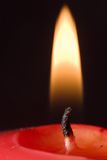 czerwony płomień świecy Obrazy Stock