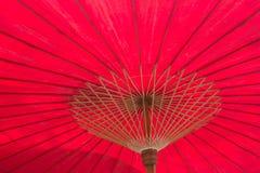 Czerwony parasol jest tłem Obraz Royalty Free