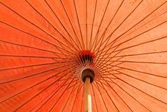 Czerwony parasol z światłem słonecznym Obraz Stock