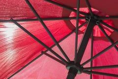 Czerwony parasol z słońcem Obrazy Royalty Free