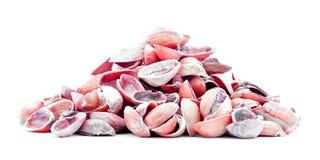 Czerwony pistacjowy nutshell rozsypisko odizolowywający na białym tle Zdjęcia Stock