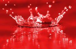 czerwony plusk Obrazy Royalty Free