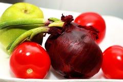 Czerwony pomidor i cebula Zdjęcia Royalty Free