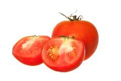 Czerwony pomidor z cięciem odizolowywającym na białym tle Obraz Royalty Free