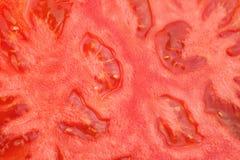 Czerwony pomidorowy tło Zamyka Up Dojrzały Pomidorowy przekrój poprzeczny Zdjęcia Stock