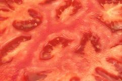 Czerwony pomidorowy tło Zamyka Up Dojrzały Pomidorowy przekrój poprzeczny Obrazy Stock