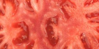 Czerwony pomidorowy tło Zamyka Up Dojrzały Pomidorowy przekrój poprzeczny Zdjęcie Stock