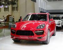 Czerwony Porsche Cayenne gts suv samochód Obrazy Stock