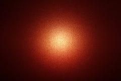 Czerwony rozjarzony tło z światłem w centrum Obrazy Royalty Free