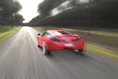 Czerwony samochód i prędkość zdjęcia stock