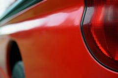 Czerwony samochodu zakończenie up fotografia royalty free