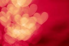 Czerwony serca bokeh abstrakta tło Fotografia Royalty Free