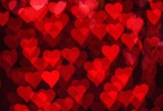 Czerwony serca bokeh jako tło Obrazy Stock