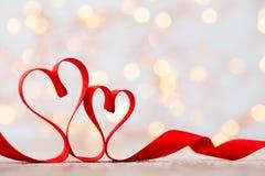 Czerwony serce faborek Walentynka dnia tło Zdjęcia Stock