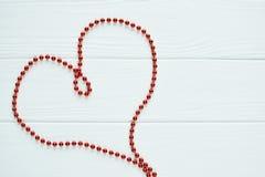 Czerwony serce koraliki Fotografia Stock