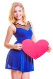 Czerwony serce. Miłość symbol. Kobieta chwyta walentynki symbol. Fotografia Royalty Free