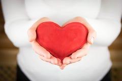 Czerwony serce w kobiet rękach Obraz Royalty Free