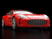 Czerwony sporta samochód odizolowywający na czarnym tle - zbliżenie strzelał - Zdjęcia Royalty Free