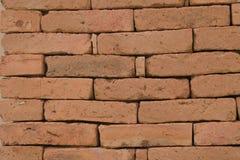 Czerwony stary kamienia bloku ściany tło Zdjęcia Stock