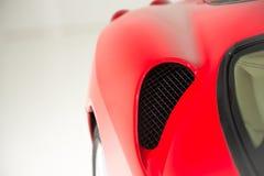 Czerwony Supercar strony szczegółu strzał Zdjęcia Stock
