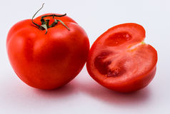czerwony tło białe pomidorowego Obrazy Stock