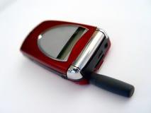 czerwony telefon komórkowy Fotografia Stock