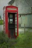 Czerwony telefonu but Obrazy Royalty Free