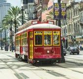 Czerwony tramwaju tramwaj na poręczu Zdjęcia Royalty Free