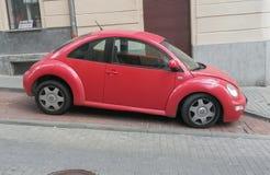 Czerwony Volkswagen New Beetle Obrazy Stock