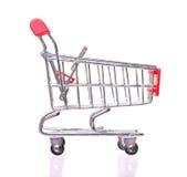 Czerwony wózek na zakupy odizolowywający na białym tle Zdjęcia Royalty Free