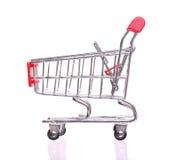 Czerwony wózek na zakupy Odizolowywający Na bielu Zdjęcie Royalty Free