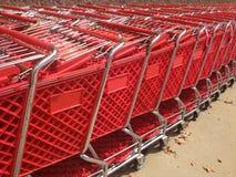 Czerwony wózek na zakupy zakończenie Zdjęcia Royalty Free