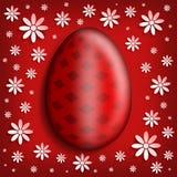 Czerwony Wielkanocny jajko na wzorzystym tle Fotografia Royalty Free
