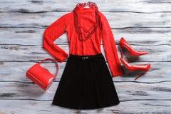 Czerwony wierzchołek z czerni spódnicą Obrazy Stock