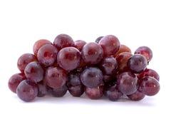 Czerwony winogrono odizolowywający na bielu fotografia royalty free