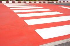 Czerwony zebry skrzyżowanie Obraz Stock