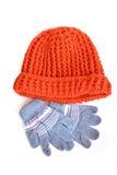 Czerwony zima kapelusz, rękawiczka na bielu i zdjęcia royalty free