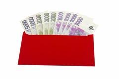 Czeska waluta, czerwona koperta Fotografia Royalty Free